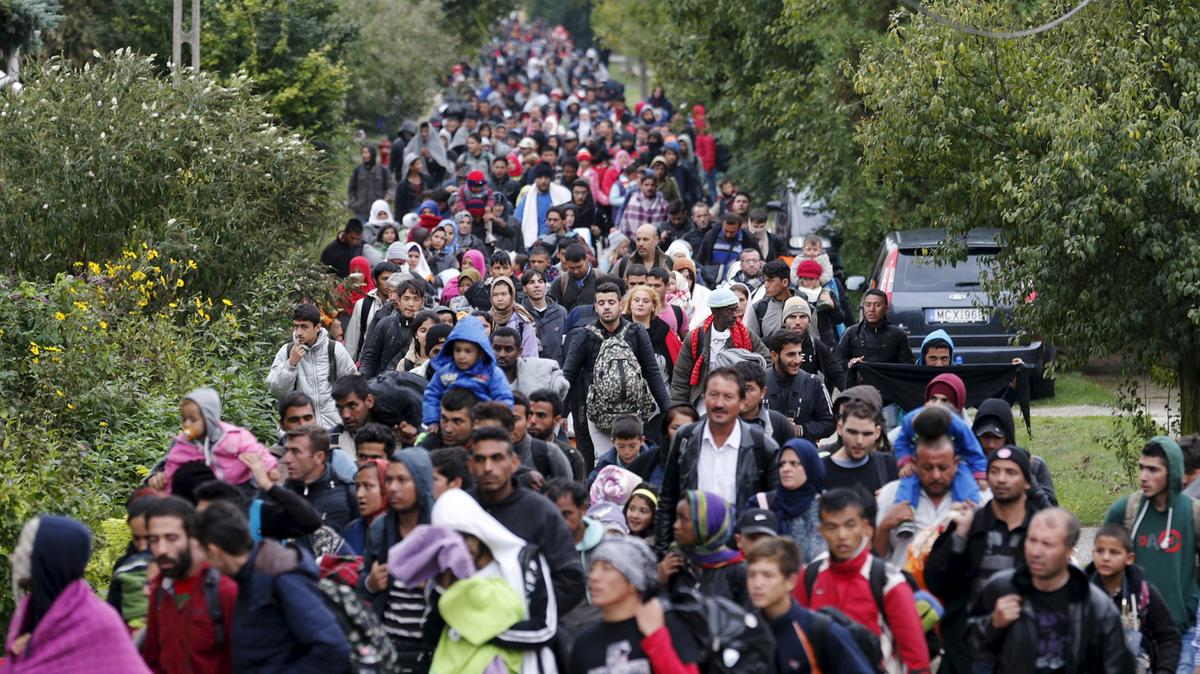 Refugees walk towards the Austrian border in Hegyeshalom, Hungary, on September 26, 2015. Heinz-Peter Bader / Reuters